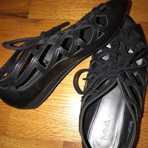 Girl MIA cut out flats with laces.